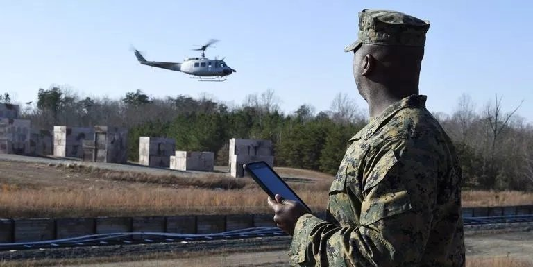 Marines test rig that makes any helicopter into a resupply drone