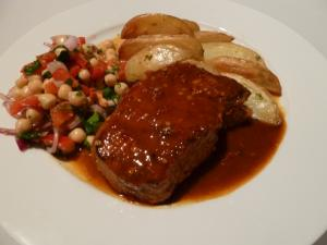 Pork with harissa sauce and salad