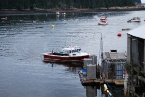 Lobster boat approached dock full of summer lobster