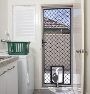 Hinged door with cat flap