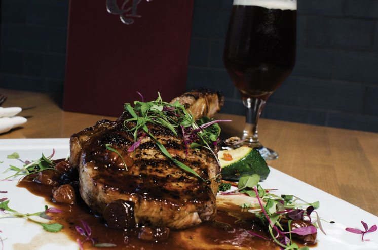 THE PAIRING: Compart Duroc Pork Chop with peewee potatoes, local vegetables and cherry demi glaze | Avery Brewing Co.'s The Reverend