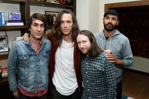 HUNTINGTON BEACH, CA - JULY 07: (L-R) Co-owner of The Bungalow Huntington Beach Brent Bolthouse, singer Brandon Boyd, guitarist Mike Einziger, and bassist Ben Kenney of the band Incubus attend the Grand Opening of The Bungalow Huntington Beach at The Bungalow Huntington Beach on July 7, 2016 in Huntington Beach, California. (Photo by Matt Winkelmeyer/Getty Images for Bolthouse Productions)
