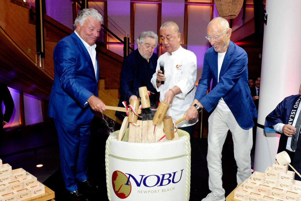 Lindsay Parton Robert De Niro Nobu Matsuhisa and Meir Teper smash the ceremonial sake barrel open at the Nobu Newport Beach Sake Ceremony