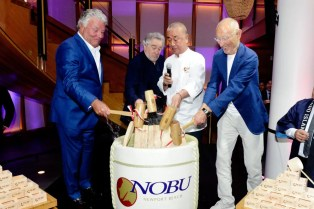 Lindsay Parton Robert De Niro Nobu Matsuhisa and Meir Teper smash the ceremonial sake barrel open at the Nobu Newport Beach Sake Ceremony