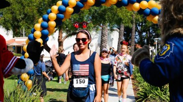 """Participants in the annual """"Run for Mercy 5K"""" hosted by Vanguard University are celebrated as they cross the finish line on September 30 at the event that raised over $6,000 to support an alumni family and their two-year-old son, Noah, who has been diagnosed with Congenital Heart Disease."""