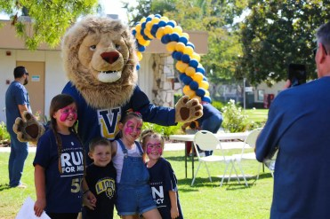 """Samson the Lion poses with new friends made at the annual """"Run for Mercy"""" 5K walk/run on September 30 at Vanguard University's Costa Mesa campus as friends, family, alumni and current students came together to raise over $6,000 to support an alumni family whose two-year-old son, Noah, is battling Congenital Heart Disease."""