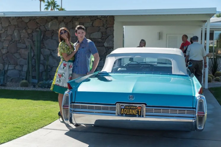 Retro attire in front of midcentury modern home photo by Jon Orlin