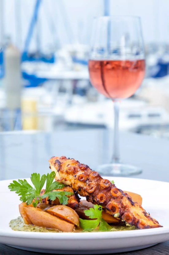 Grilled Spanish Octopus Fingerling Potatoes / Paprika / Salsa Verde Photography By: JP Cordero Photography