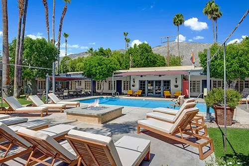 CHAISES AND FIRE PIT ANGLED TO POOL AND HOTEL MLS small