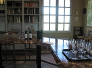Chateau Haut Brion tasting room bottles and wine glasses photo copyright Paige Donner 2017 IMG_2658