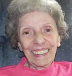 Dora C. Adams, 87