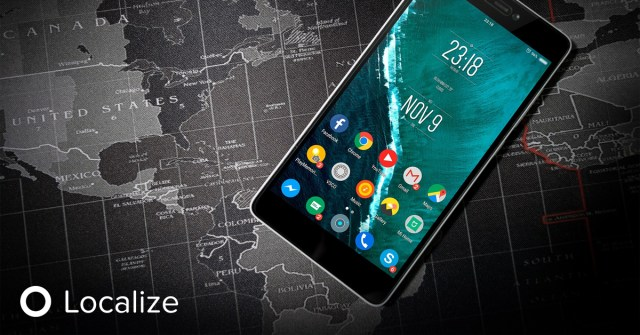 Localizing for your mobile app. Image of a mobile phone set on top of a black and white map of the world.