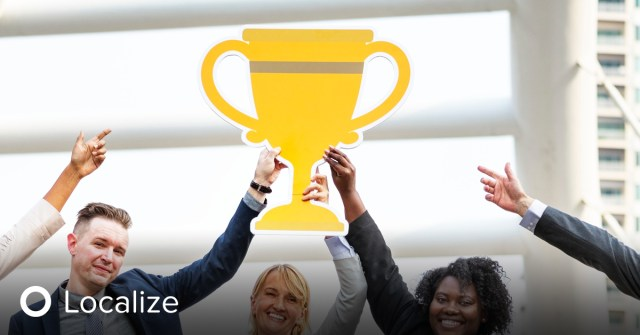 What to Look for in a Good Translation Software: team holding up a trophy