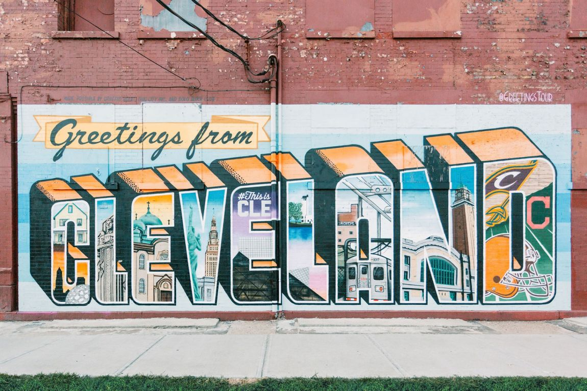 Cleveland painted as vintage postcard on brick wall