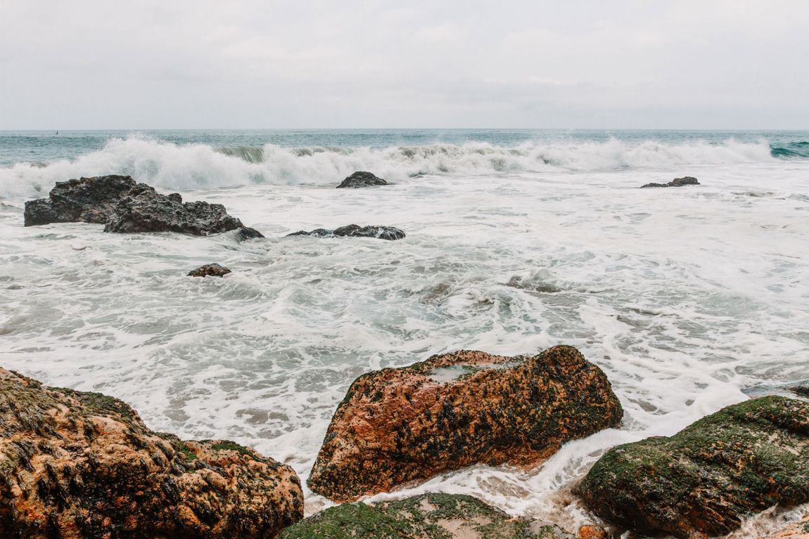 Waves crashing on rocks at Pirate's Cove, Malibu California | as seen on the Local Love and Wanderlust Blog