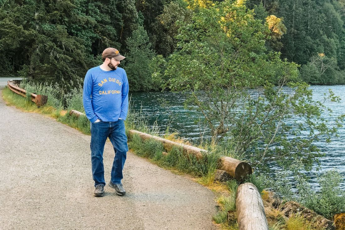 Man walking the shore of Crescent Lake, Olympic National Park   Local Love and Wanderlust