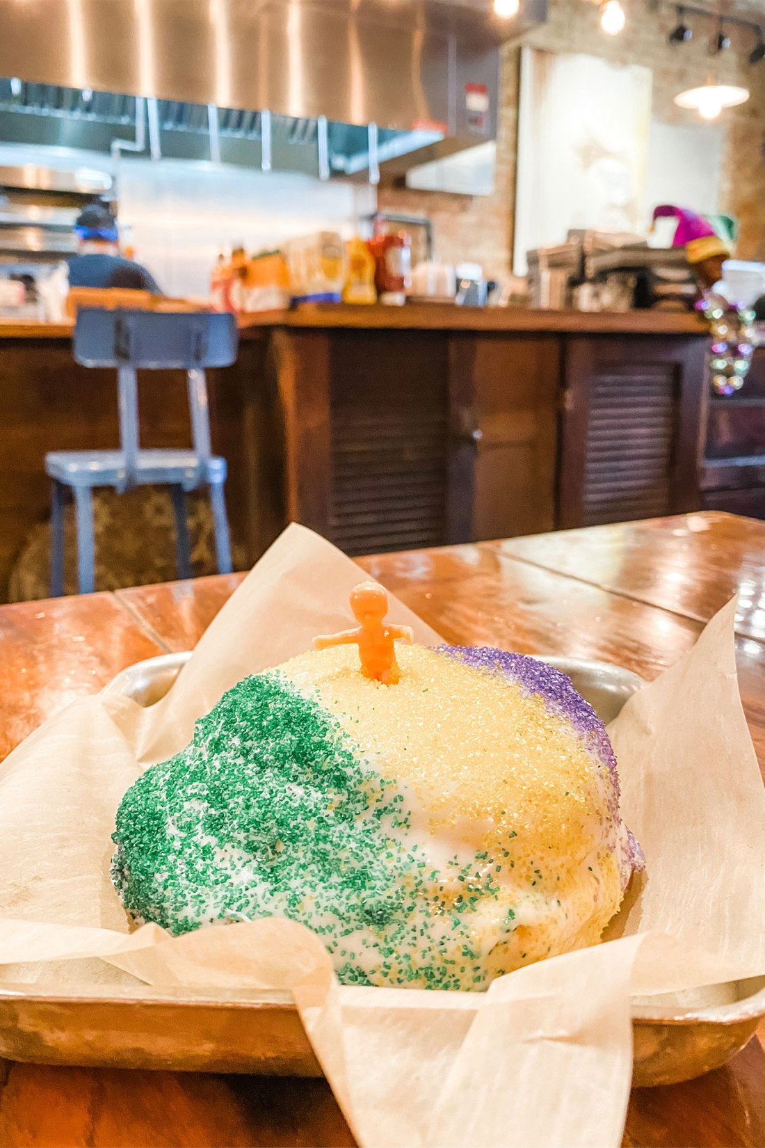 Donut covered in green, yellow, and purple sprinkles in New Orleans