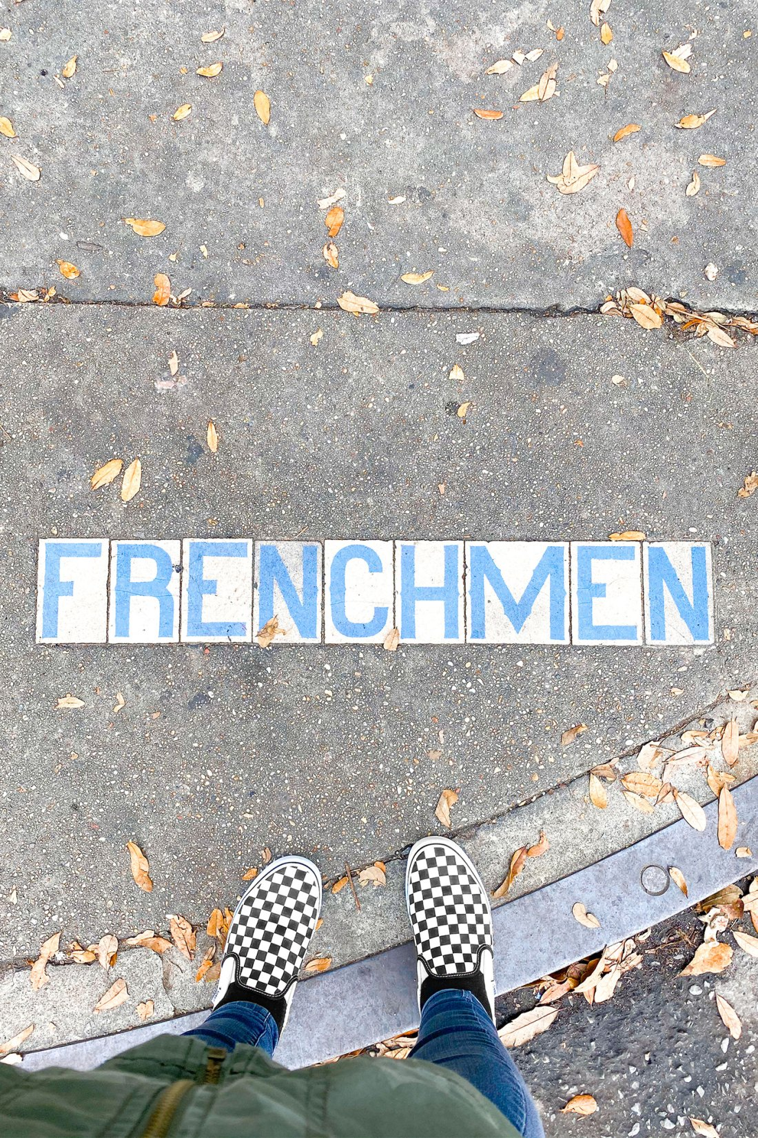 Tiles embedded on sidewalk with street name in New Orleans