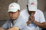 Anger and disbelief from MH370 China relatives over debris - 2