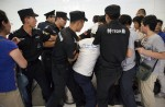 Anger and disbelief from MH370 China relatives over debris - 1
