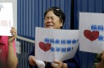 Anger and disbelief from MH370 China relatives over debris - 12