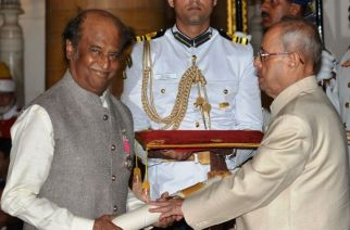 Filmstar Rajinikanth receiving Padma Vibhushan award from President Pranab Mukherjee