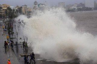Mumbai : People enjoying a high tide at Marine Drive in Mumbai on Wednesday. PTI Photo (PTI7_16_2014_000133B)