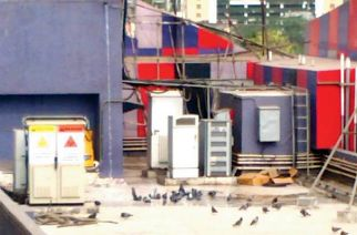 Photo Courtesy: Mid Day; a screenshot from the video shows pools of water near the overhead tank of Jaihind Cinema