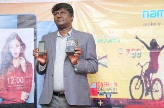 Promoter Madhava Reddy unveiling the 'Acche Din' smartphone