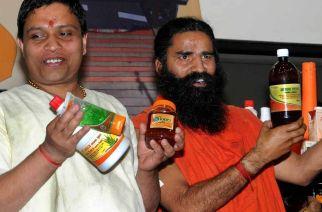 Acharya Balkrishnan and Baba Ramdev unveiling new Patanjali products