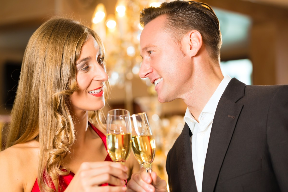 couple man woman cheers champagne gala event