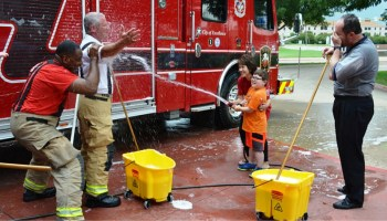 Plano Mayor washes fire truck for Muscular Dystrophy Association.