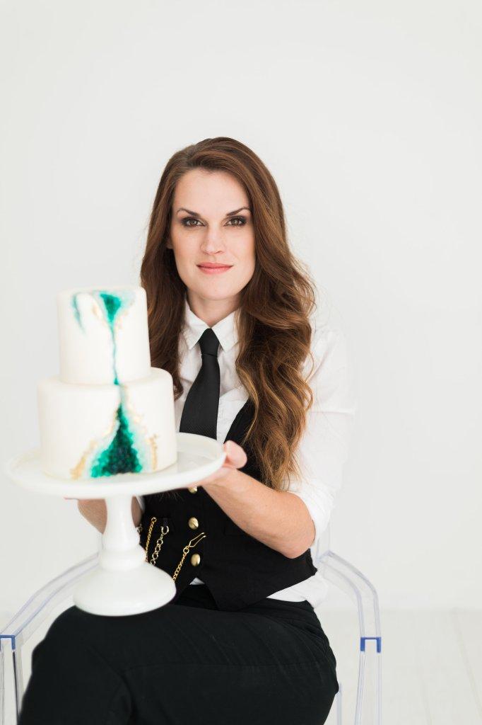 Elizabeth Rowe with a custom geode cake