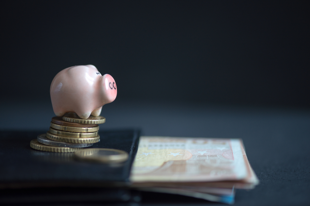 piggy bank and coins economic impact