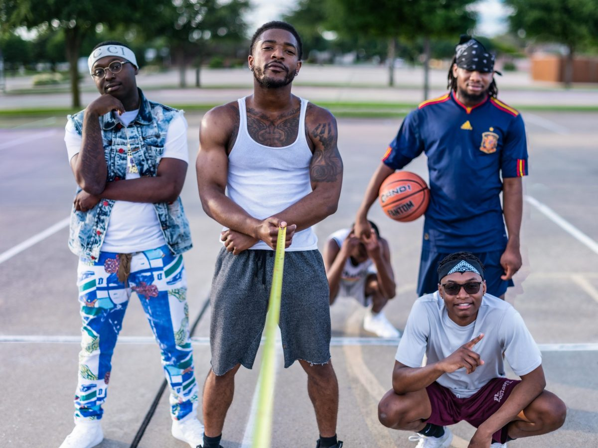 group of boys playing basketball six feet apart