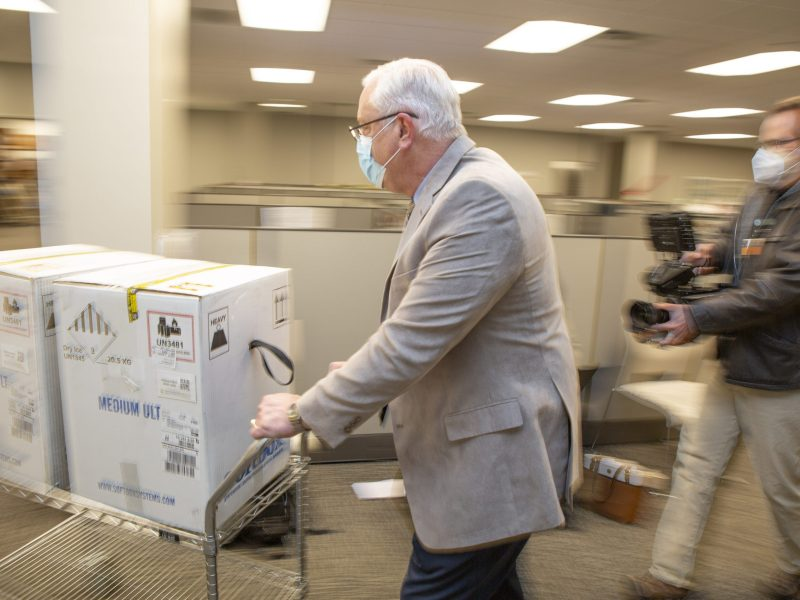 texas health rolling cart with vaccines scaled