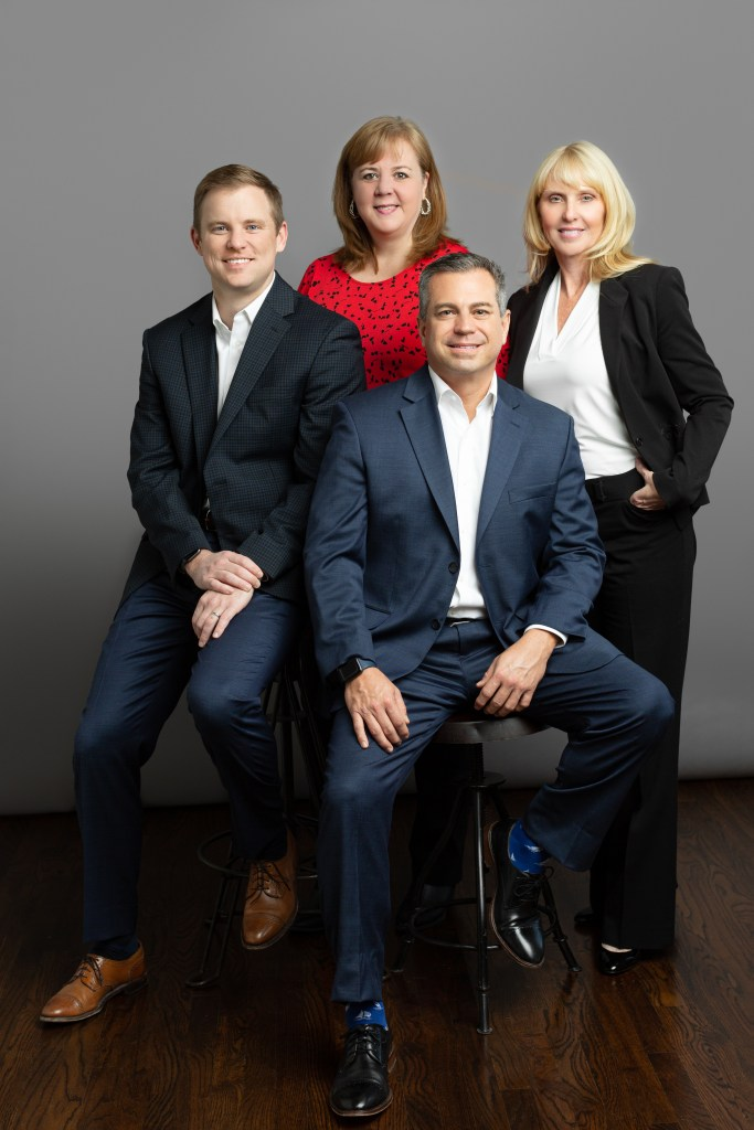 part of the team at astra wealth management group. l to r: john darden, jill tucker, andy evans and candy hawkins.
