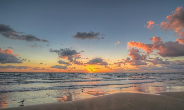 sunrise over the beach at south padre island, texas coast | best texas getaways