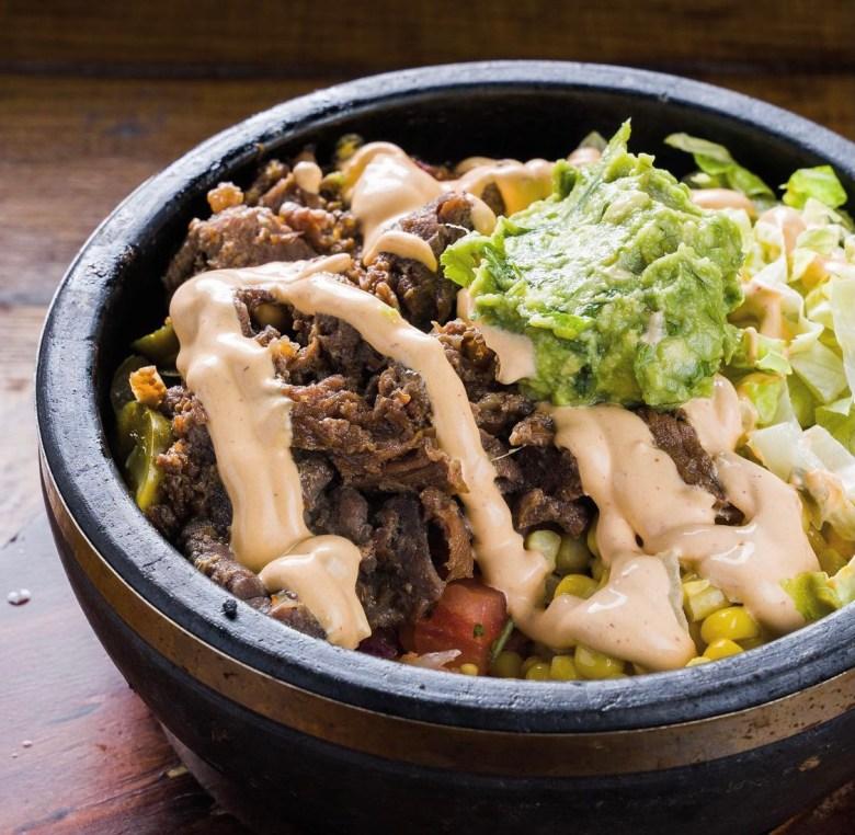 the worlds of texas and korea collide with the bulgogi burrito bowl | via @madforchickenusa on instagram
