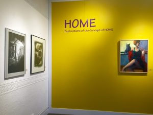 "The current exhibit explores the concept of ""HOME""."