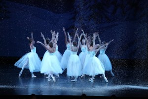Snowflakes fall on Nutcracker dancers.