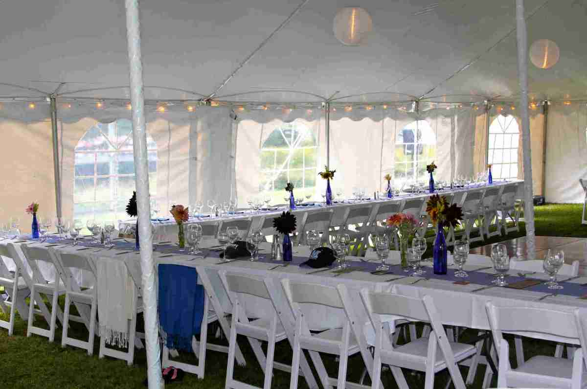 Wedding reception tables inside tent