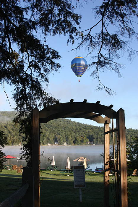 Hot Air Balloon over Post Pond viewed through arch at Loch Lyme Lodge