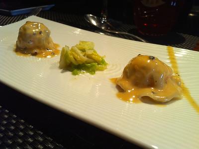 Langoustine ravioli in truffle sauce
