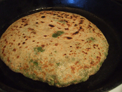 Puffed flatbread, stuffed with spiced peas, ready to eat