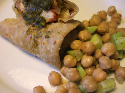 Kathi roll served with coriander chutney and chickpea salad
