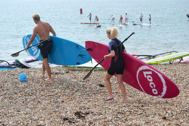 couple-walking-with-boards