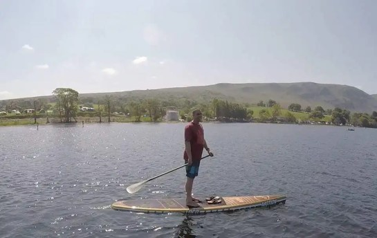 Joe paddling 12'6'' Motion Wood Touring Raceboard