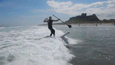 Paddle Surfing With Friends in Bamburgh Northumberland