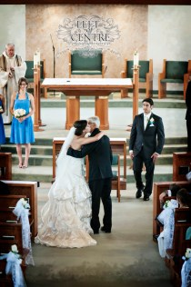 Bride Kissing Father down the aisle